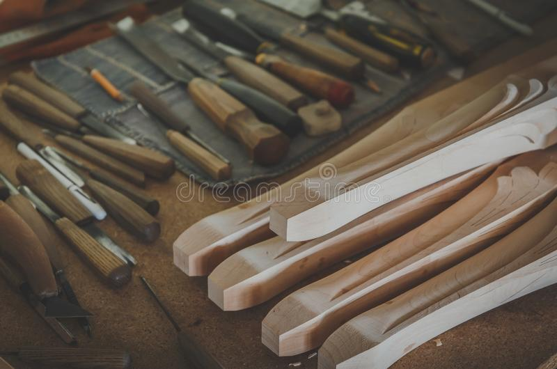 Wood processing. Joinery work. wood carving.wood billets for furniture, chisels for carving close up. small depth of field. instag stock images