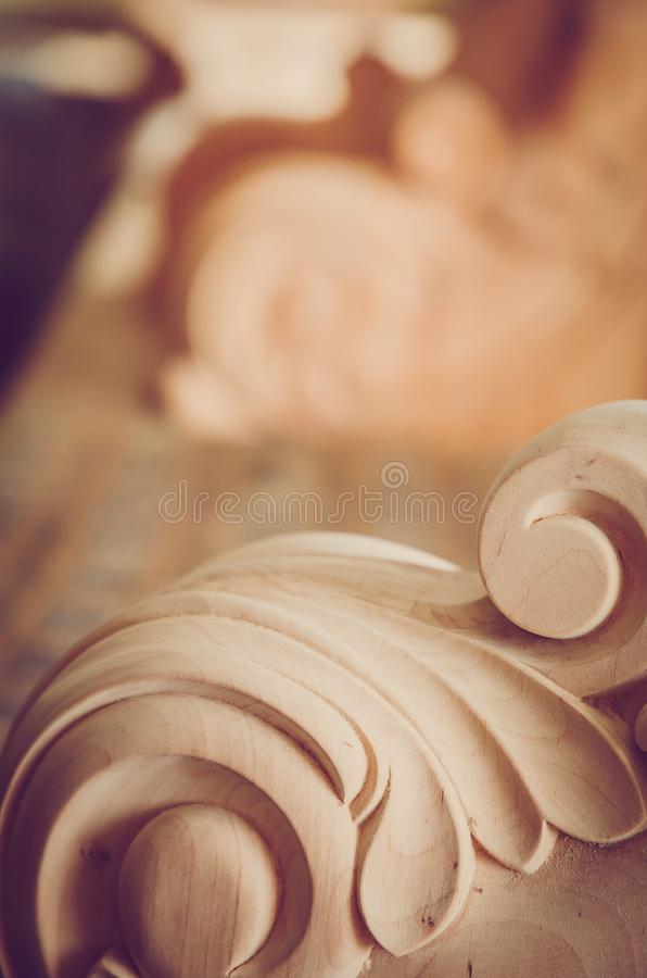 Wood processing. Joinery work. wood carving. the carving element. close up. small depth of field.instagram toning effect. use as b royalty free stock photos