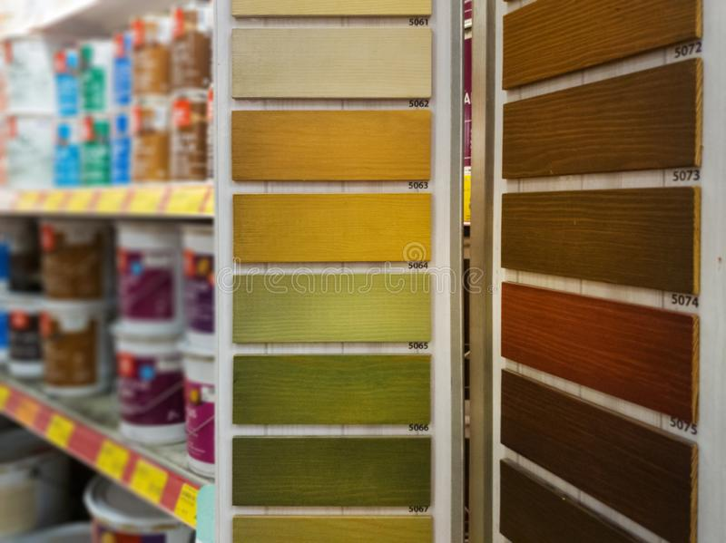 Wood stain samples in building material store. Wood protective paint color samples in building material store stock photography
