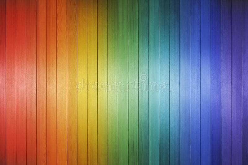 Wood Rainbow Background Texture. A wood background made with the colours of the rainbow