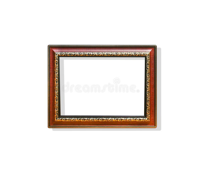 Wood rectangle picture frame with flower carving steel patterns ar around isolated on white backgroun with clipping path royalty free stock photography