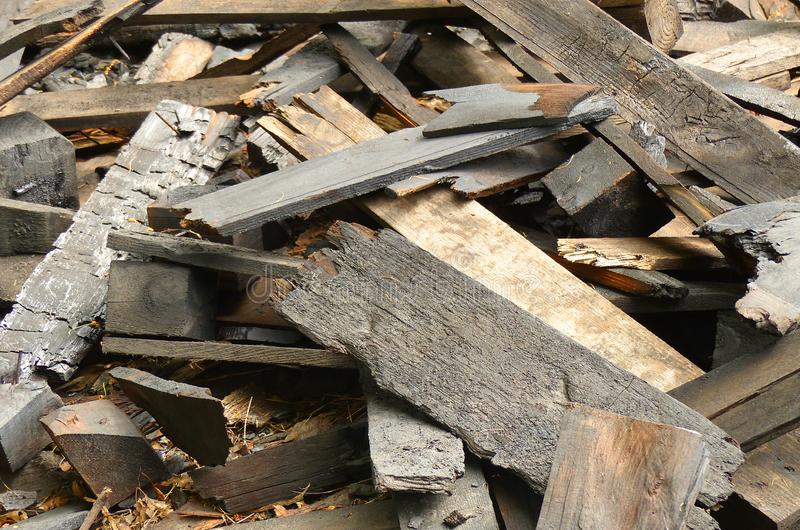 Wood remains and burned wood. Boards royalty free stock photo