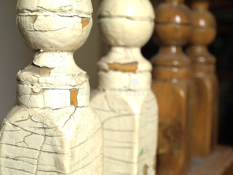 Wood Restoration. Old lead painted wooden spindles are stripped and restored stock photography