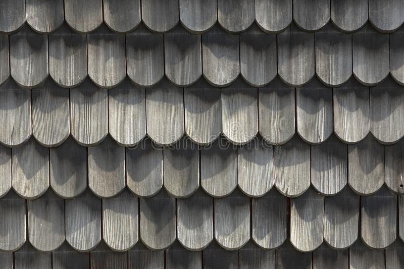 Wood roof - old traditional method for roofing - roof shingles. And shakes are renowned for their insulation qualities royalty free stock images