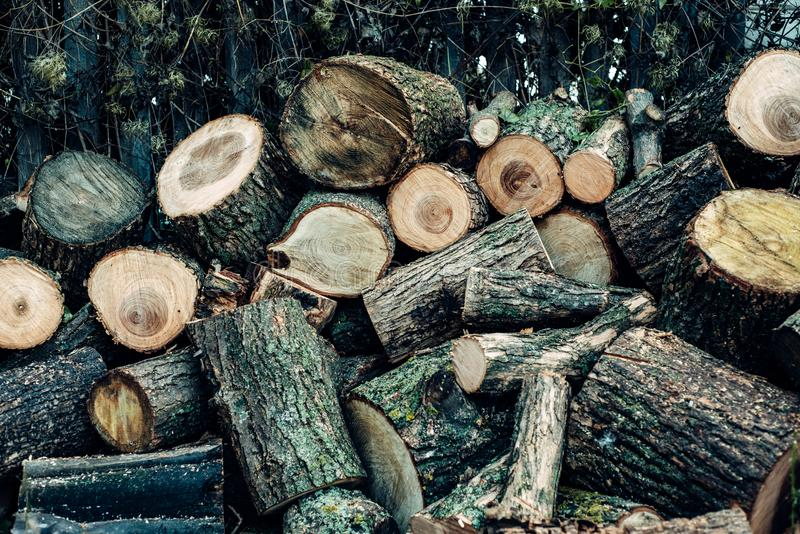 Wood is sawn into many small pieces. The wood is sawn into many small pieces, lying a heap one on one under the fence stock images