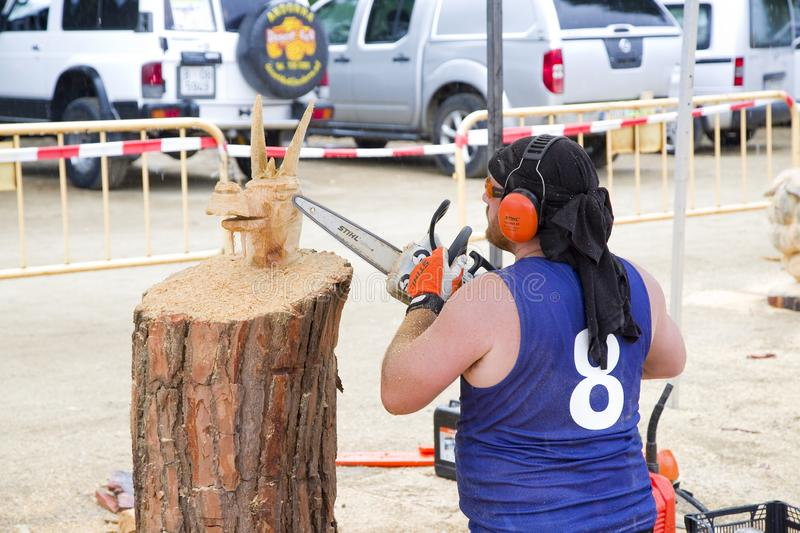 Wood sculpture with chainsaw. Wood sculpture competition with chainsaw, on July 27, 2019, in Alella, Barcelona, Spain royalty free stock photos