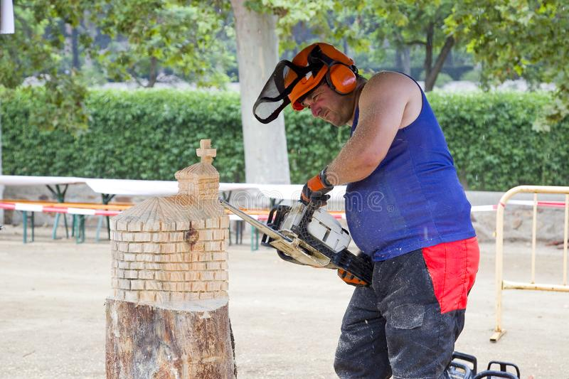 Wood sculpture with chainsaw. Wood sculpture competition with chainsaw, on July 27, 2019, in Alella, Barcelona, Spain stock photography