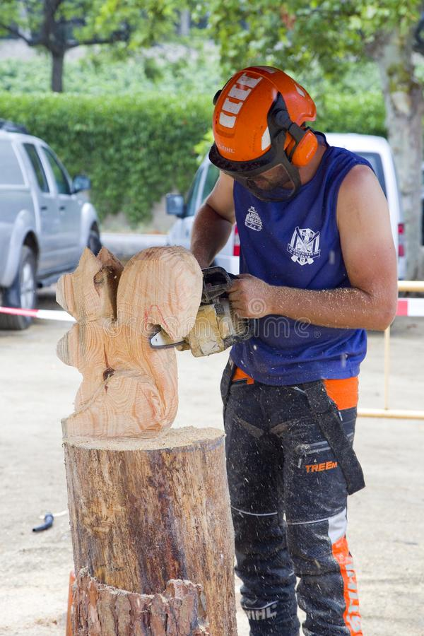 Wood sculpture with chainsaw. Wood sculpture competition with chainsaw, on July 27, 2019, in Alella, Barcelona, Spain royalty free stock photography