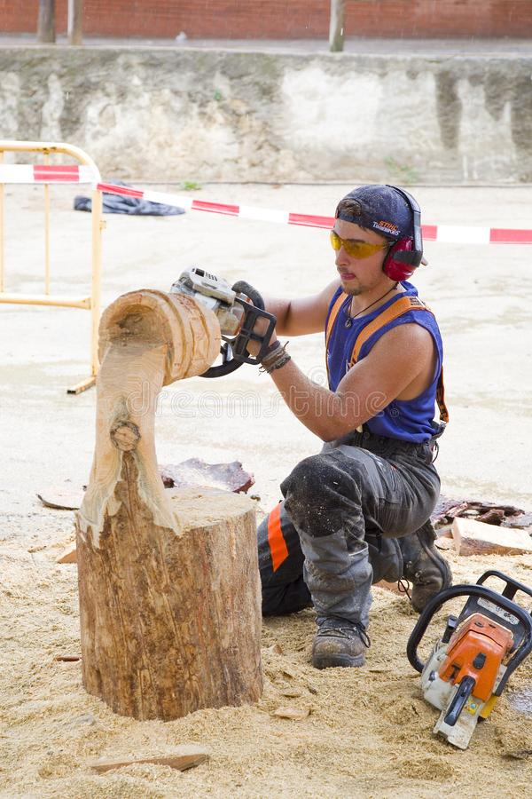 Wood sculpture with chainsaw. Wood sculpture competition with chainsaw, on July 27, 2019, in Alella, Barcelona, Spain royalty free stock image
