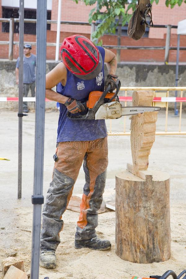 Wood sculpture with chainsaw. Wood sculpture competition with chainsaw, on July 27, 2019, in Alella, Barcelona, Spain stock image