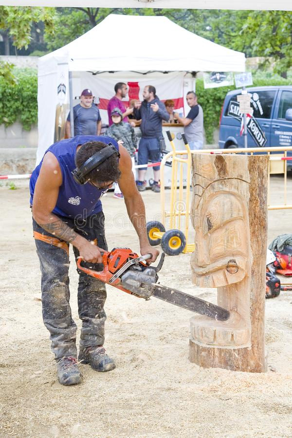 Sculpture with chainsaw. Wood sculpture competition with chainsaw, on July 27, 2019, in Alella, Barcelona, Spain royalty free stock photo