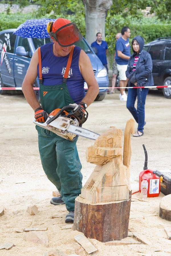 Sculpture with chainsaw. Wood sculpture competition with chainsaw, on July 27, 2019, in Alella, Barcelona, Spain stock photos