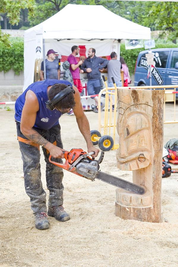 Sculpture with chainsaw. Wood sculpture competition with chainsaw, on July 27, 2019, in Alella, Barcelona, Spain royalty free stock photos