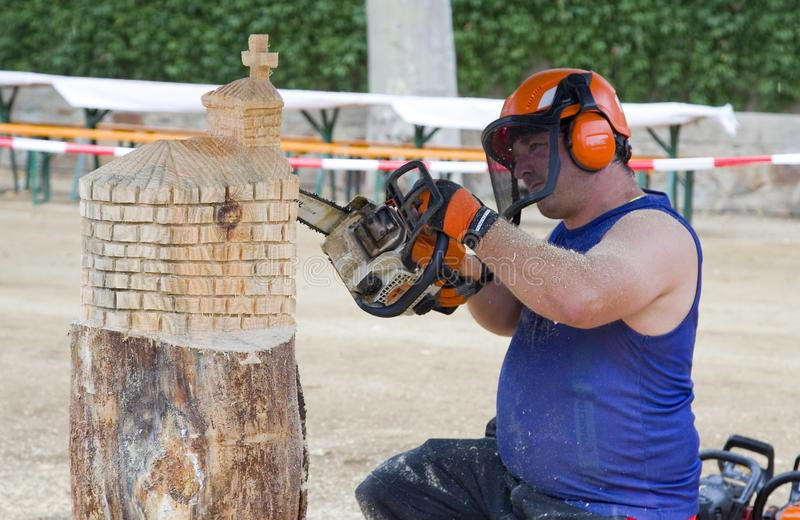 Sculpture with chainsaw. Wood sculpture competition with chainsaw, on July 27, 2019, in Alella, Barcelona, Spain royalty free stock image