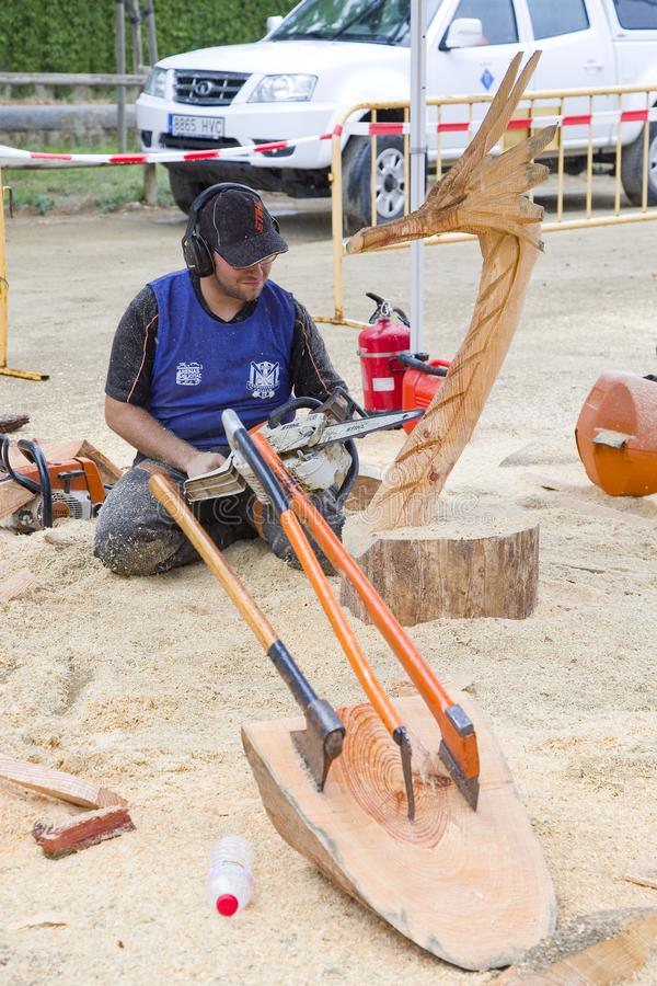 Wood sculpture with chainsaw. Wood sculpture competition with chainsaw, on July 27, 2019, in Alella, Barcelona, Spain stock photos