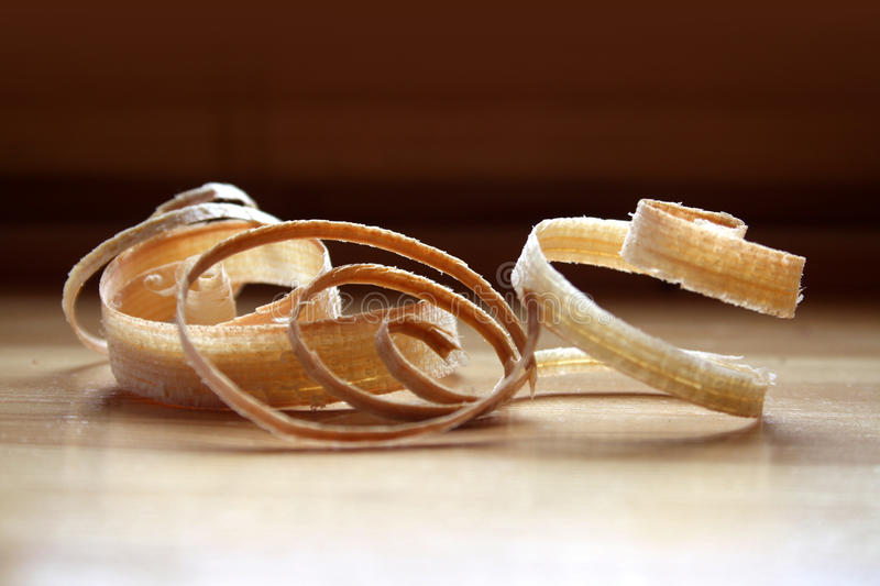 Wood shavings. Woodchip on carpenter's workshop table stock photography