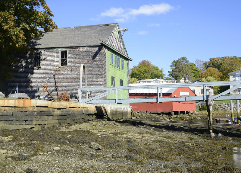 Wood shed by harbor in low tide royalty free stock photos