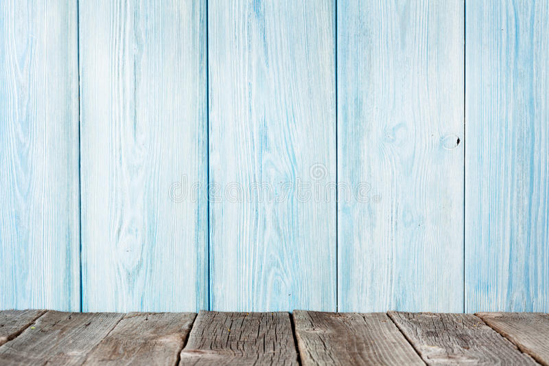 Wood shelf in front of wooden wall. View with copy space stock photos