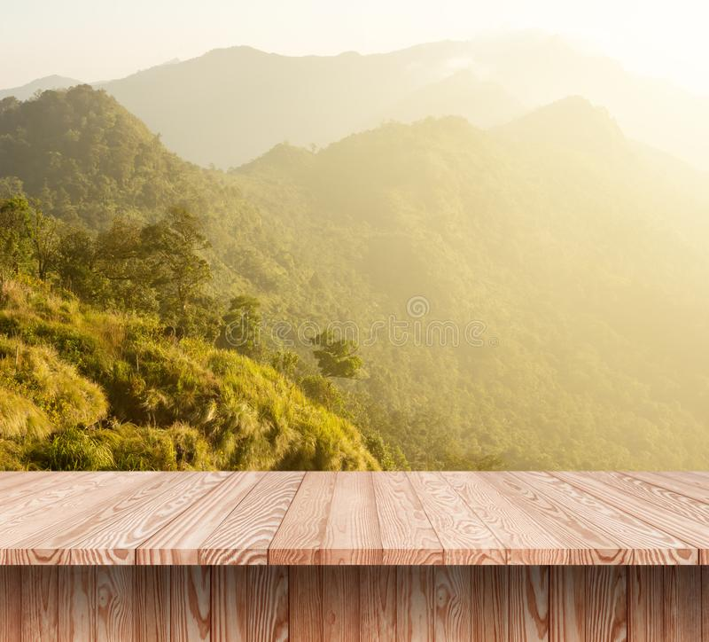 Wood table top on background of mountain view in the morning royalty free stock photos