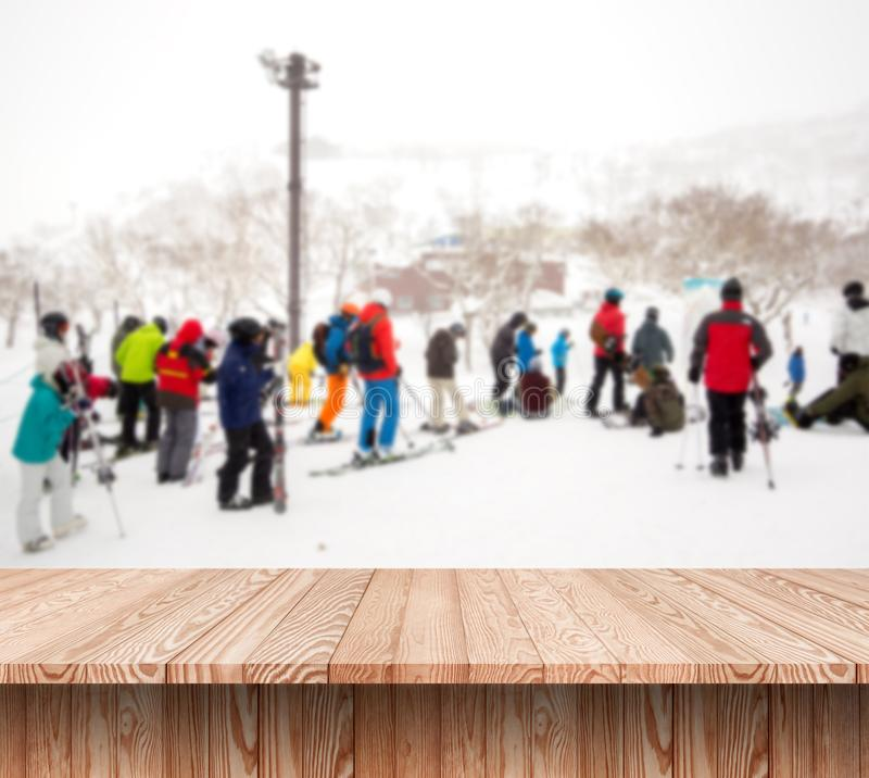 Wood shelf table with blurred background of winter. Time and many people skiing in ski resort stock photos