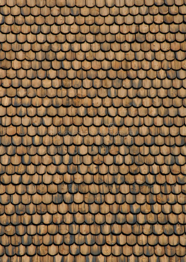 Wood shingle roof. Real wood shingle roof texture surface front view royalty free stock photo