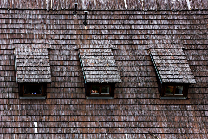Wood shingle roof texture. Garret roof. Absrtact architectural background stock photos