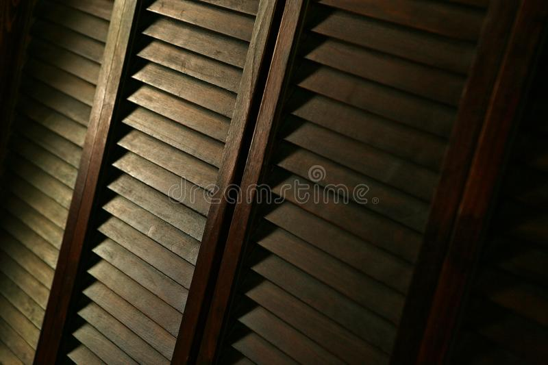 Wood shutters in low light royalty free stock photography
