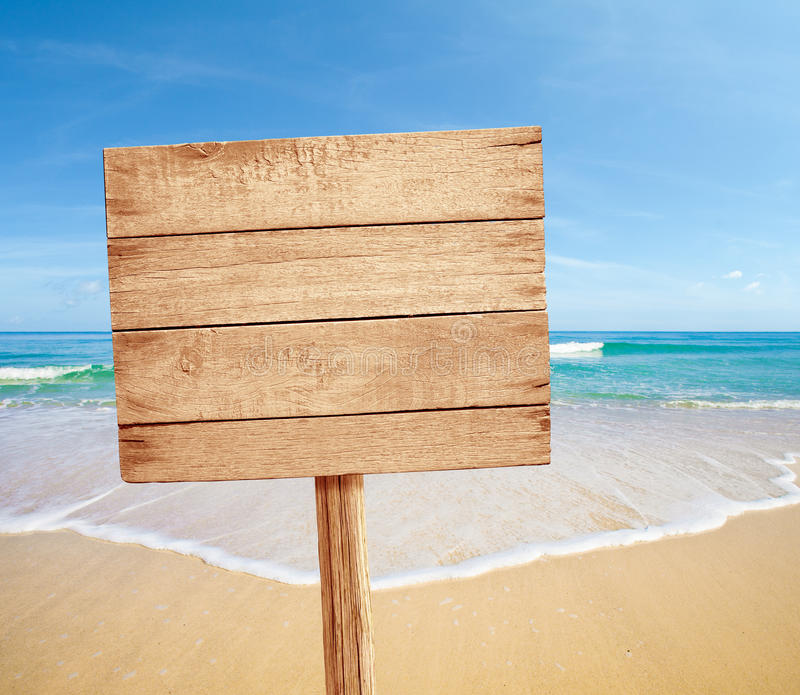 Wood sign on sea beach royalty free stock image