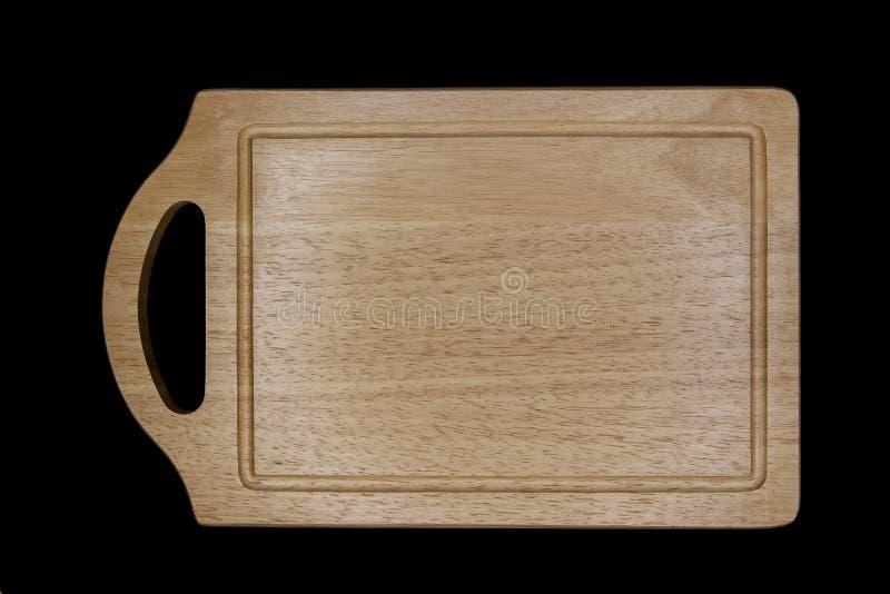 Wood skärbräda i svart bakgrund royaltyfri foto