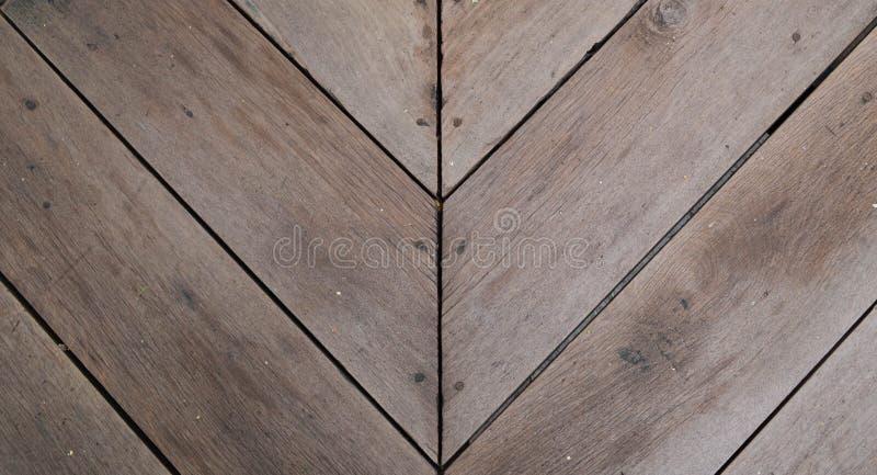 Wood slat floor with arrow shape. Brown wood slat floor with arrow shape, fasten with nail royalty free stock image