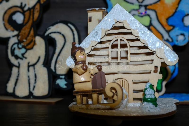 Wood small Christmas toy house closeup detail view stock image
