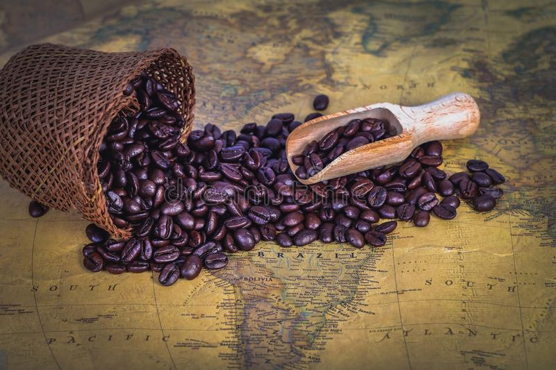 Wood spoon with coffee bean in sack bag. On background stock photo