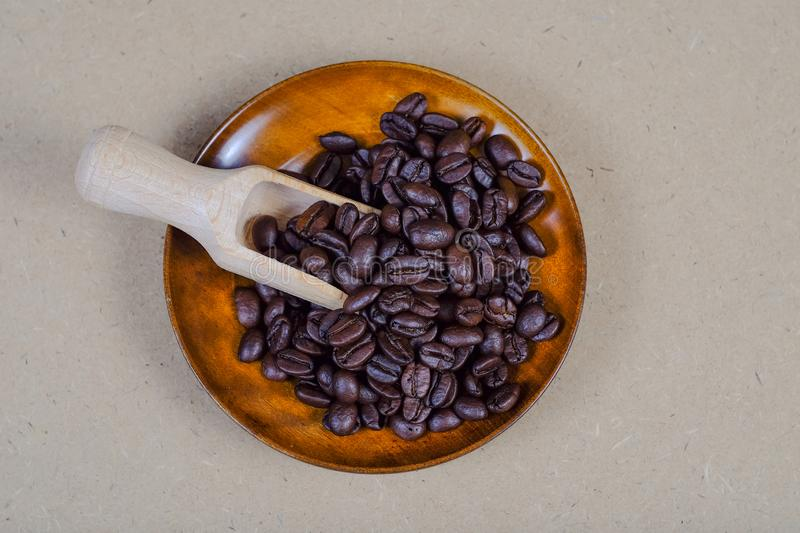 Wood spoon with coffee bean on vintage map. Background stock image