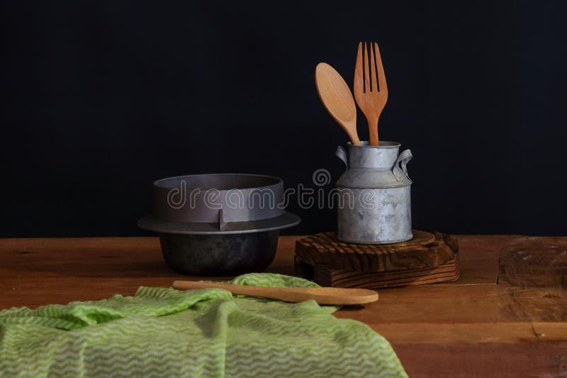 Wood spoon and fork in cup , still life. Concept royalty free stock image