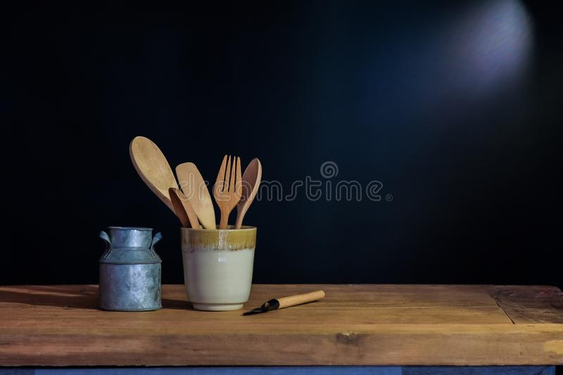 Wood spoon and fork in cup , still life. Concept stock photos