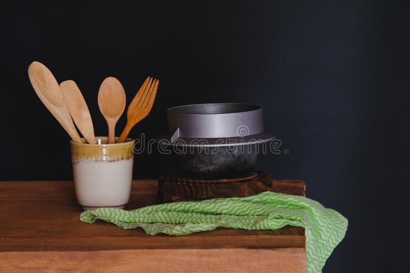 Wood spoon and fork in cup , still life. Concept royalty free stock photography