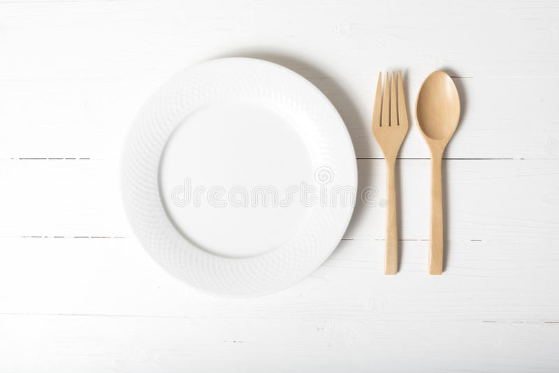 Wood spoon and fork with dish royalty free stock photography