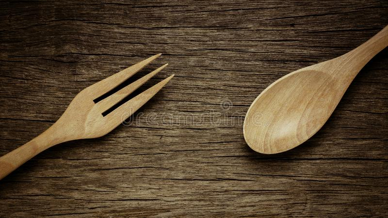 Wood spoon and fork on old wooden desk. - vintage style stock images