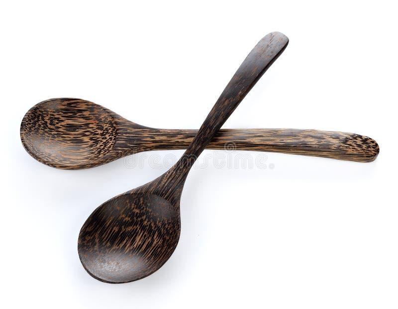 Wood spoon on white background stock photos