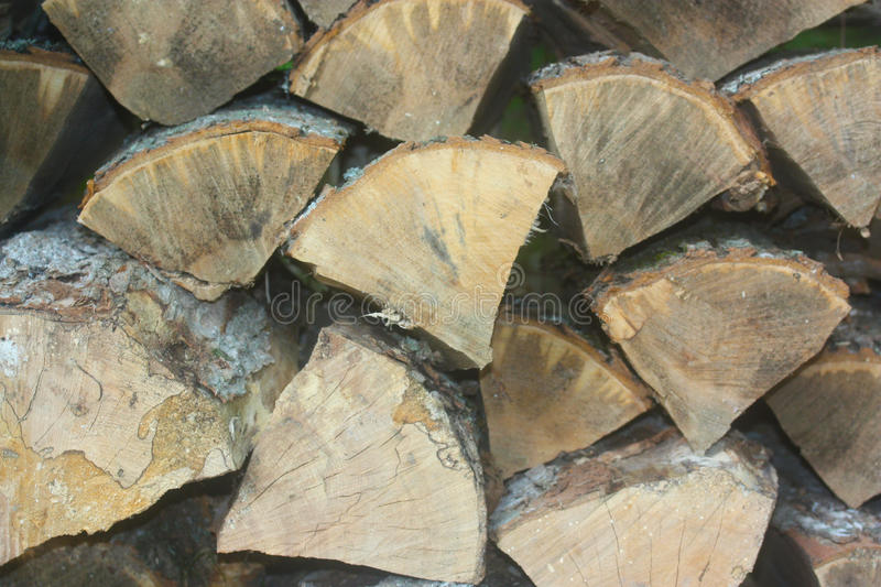 Wood. Stack closeup grey texture logs log split brown beige grey background stock photo