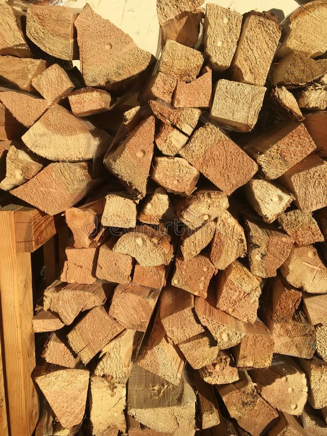 Wood stack. Cut stacked wood is ready for you in the colder weather to use in your fireplace or backyard barbecue to roast marshmallows royalty free stock photo