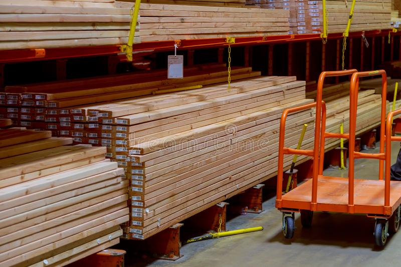 Wood stacked on shelving inside a lumber yard royalty free stock photo