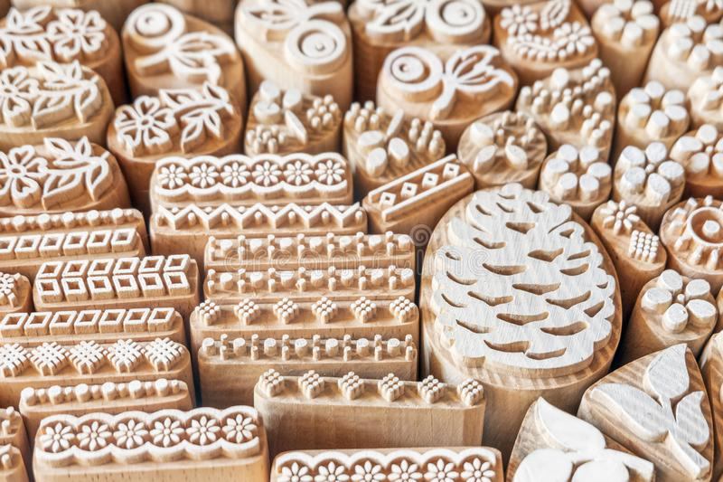 Wood stamp for application drawing. Patterns on wooden surface of mold blocks for printing textile stock photography