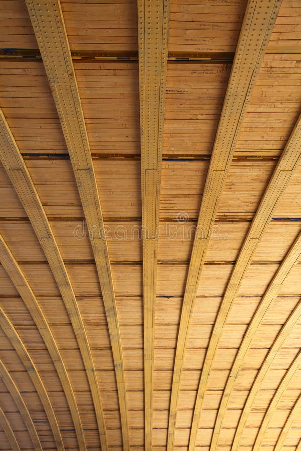 Wood and steel bridge detail. Wide angle view of wood slats and steel girder bridge details stock image