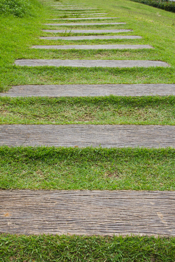 Wood step on grass. stock photo