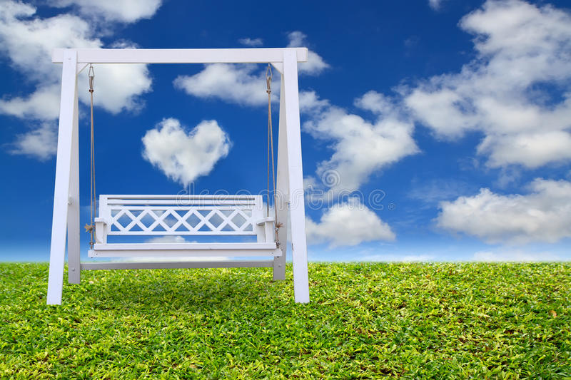 Download Wood Swing Chair With Beautiful Cloud Stock Image - Image: 25207915