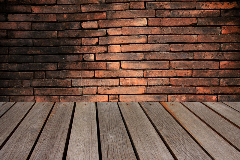 Wood table and abstract red brick wall Background. stock photos