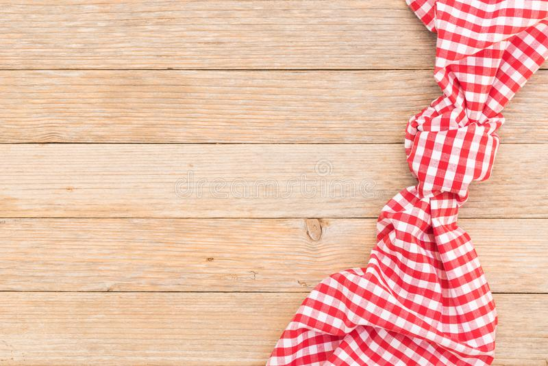 Rustic menu background, wood table with red checked tablecloth, copy space. Wood table background with red checkered tablecloth, high angel view stock image