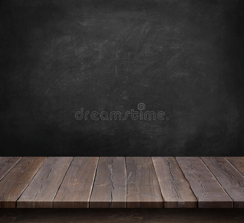 Wood table with blackboard background royalty free stock image