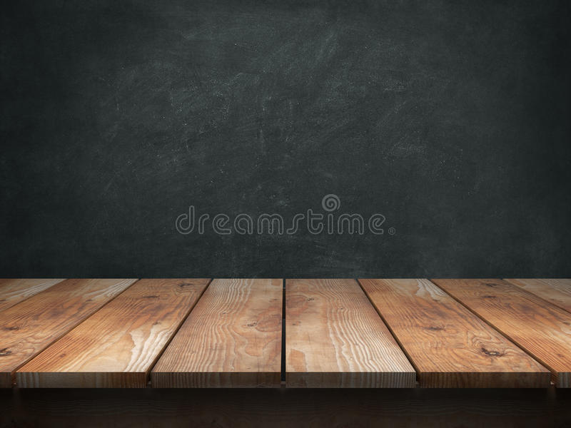 Wood table with blackboard background stock images